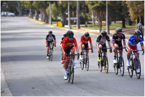 David in the black and purple kit rolling turns with some semi professional riders at the Glenvale A Grade Criterium.