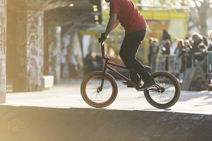 BMX bike rider in skate park