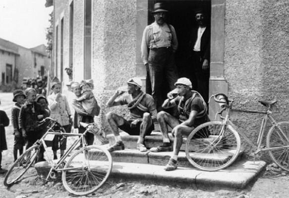 Cyclists drinking beer