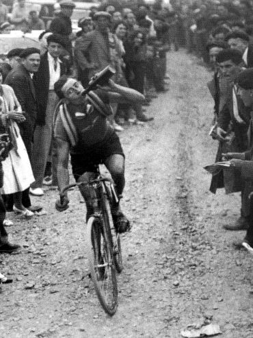 old school cyclist drinking beer