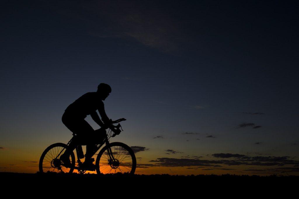 man riding bicycle during nightfall 207779